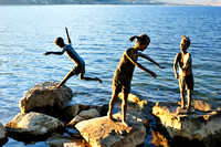 Statues of children, rocks, water, Penticton